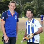 MELBOURNE, AUSTRALIA - AUGUST 07:  Drew Petrie of the Kangaroos and Ricky Ponting pose pose during a media opportunity at Ferndale Park on August 7, 2016 in Melbourne, Australia.  (Photo by Jack Thomas/AFL Media)